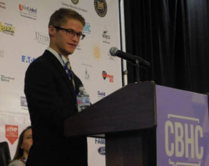 Jake Thornton speaks during the Community Behavioral Health Conference earlier this month. Thornton spoke about his experiences growing up with autism during a panel called,